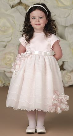Satin and organza tea-length A-line fancy baby dress and toddler girl dress with short sleeves, satin bodice with waistband features a side bow and tieback sash, scalloped tiered organza overlay skirt with hand-beaded flower motif on side.