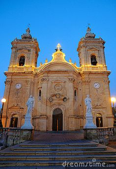 Evening view of illuminated Church of Our Lady of Victory in Xagra, Gozo island, Malta