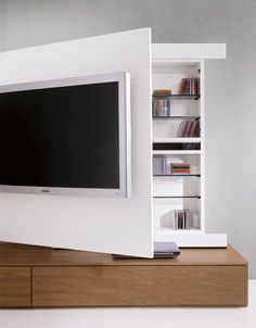 I've spent weeks trying to figure out the best way to wall-mount my TV in the living room (Elegant Behind TV Storage Ideas That Are Secret Places).