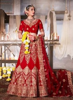 Red traditional embroidered bridal wear langha choli in velvet