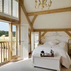 Check out this brand new house tours as featured in Country Homes & Interiors magazine. Step inside this rustic Kent new-build house where farmhouse style is given a contemporary twist. Farmhouse Style Bedrooms, Bedroom Rustic, Bedroom Country, Scandinavian Style Home, Country House Interior, A Frame Cabin, Interiors Magazine, Country Style Homes, Building A House