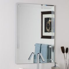 Decor Wonderland 23.6-in x 31.5-in V-Groove Edge Mirror $98 @ Lowes