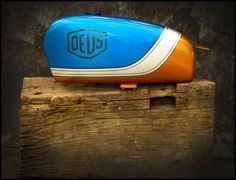 deus ex machina blue and orange gas tank
