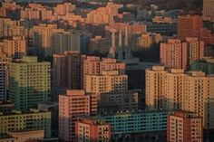 The Pyongyang city skyline with a view of the 50-metre-high Monument to Party Founding, comprising a hammer, sickle and brush, which was built to commemorate the 50th anniversary of the Workers' party of Korea