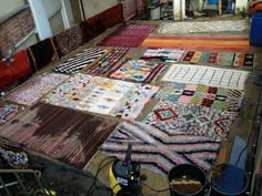 A batch of rugs laid out for a professional clean