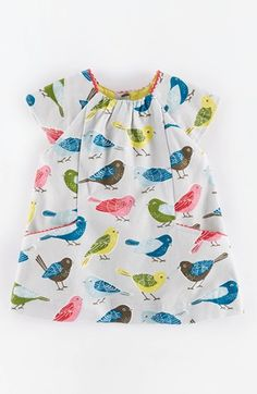 Free shipping and returns on Mini Boden 'Pretty' Pleated Corduroy Dress (Baby Girls) at Nordstrom.com. A pretty print covers a classic short-sleeve dress, shaped with mini pleats and finished with rickrack-tipped pockets.