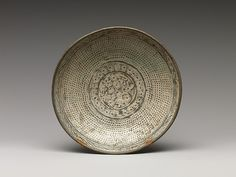 """Dish with inscription and decoration of chrysanthemums and rows of dots, mid-15th century. Joseon dynasty (1392–1910). Korea. The Metropolitan Museum of Art, New York. Gift of Mr. and Mrs. Samuel Colman, 1893 (93.1.216) 
