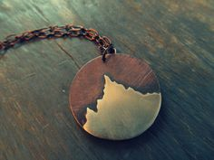 The Peak: Mountain Pendant - Copper and Sterling Silver Mountain Necklace - Winter Jewelry. $55.00, via Etsy.