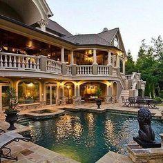 Backyard with a multi level wraparound balcony. www.findinghomesinhenderson.com
