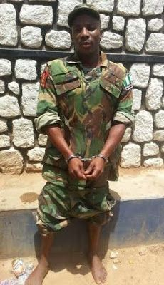 Photo: Fake soldier who wears full military camouflage to extort money from residents arrested in Kaduna