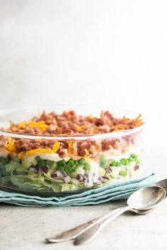 Bright, crunchy, and colorful, this easy Seven Layer Salad recipe is a fun blast from the past for any party. Make it as-is or switch up the layers any way! Fruit Salad Recipes, Chicken Salad Recipes, Strawberry Recipes, Veggie Recipes, Cooking Recipes, Jello Salads, Fruit Salads, Veggie Food, Cooking Tips