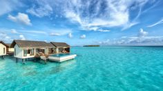 The Residence Maldives: Thatch-roofed Water Villas hover above the Indian Ocean.