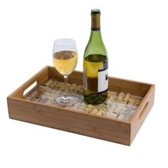 The Wine Cork Serving Tray Kit is a DIY serving tray made of bamboo and corks saved from wine bottles. The glass pane in the Wine Cork Bamboo Service Tray Kit protects the corks and holds them in plac