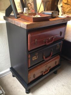 Endtable drawers replaced with uniform-size suitcases.  LOVE!