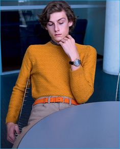 Front and center, Benjamin Vytiska wears a mustard yellow Mango sweater with Dockers trousers, a Hermes belt and Calvin Klein watch.