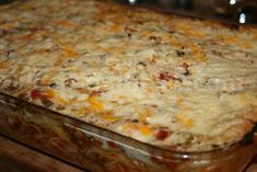 Baked Spaghetti - A perfect potluck casserole, using a basic tomato based spaghetti meat sauce, a layer of spaghetti noodles and cheese and finished with a cream soup topping.
