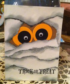 handmade Halloween card ... great version of the mummy eyes card design ... torn and sponged edges on the mummy wrap ... punch art eyes with googly centers ...
