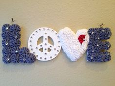 "Peace and ""LOVE"" Wood Letters covered in fabric yo-yos.  on Etsy, $12.00"