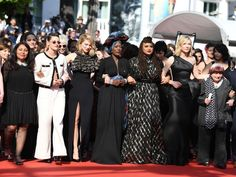 Women protest on the red carpet at Cannes -  Hollywood stars took over the red carpet at the Cannes film festival in a call for equality among men and women.  Cate Blanchet Kristen Stewart and Salma Hayek were among 82 actresses filmmakers and producers who stood arm in arm.  Image: The number of women represents 82 films by female directors who have competed for the top Palme d'Or prize since 1946  The number of protesters represented the 82 films by female directors who have competed for…
