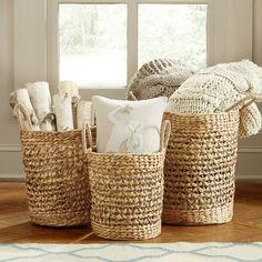 Fairport Seagrass Baskets | An open weave gives these baskets an airy feel with just a touch of bohemian style. Thick rope handles make it easy to load with spare blankets and move from room to room.