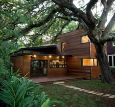 Minimalist wood house exterior surrounded by the trees