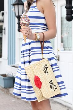 Adorable dress and whimsy clutch.