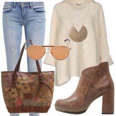 Jeans e maglia chiari, contornati dai caldi colori autunnali dei tronchetti, della borsa e degli accessori. Outfit confortevole, adatto per sbrigare le incombenze quotidiane in giro per la città senza rinunciare allo stile!