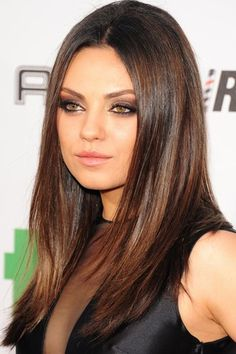 Just how does Mila Kunis get that shine-tastic hair.
