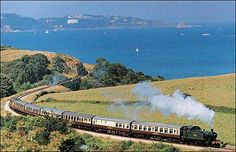 Agatha Christie's home at Greenway was close to the Paignton to Dartmouth Railway. She often caught the train to Churston Station, where she would be picked up by car. Hercule Poirot also took this train in 'The ABC Murders' and 'Dead Man's Folly'. Train Tracks, Train Rides, Old Steam Train, Steam Railway, Devon England, South Devon, Devon And Cornwall, Old Trains, Agatha Christie