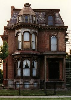 A beautiful brick Victorian in Brush Park, Detroit. I *love* this little house. The pattern on the roof tiles, the bay windows, everything.