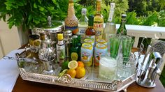 The porch bar for cocktail parties. Love the idea of using the silver tray :)