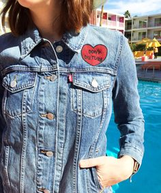 A desert vacation essential? According to @refinery29 , a customized, Levi's denim Trucker Jacket is a must have.