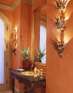 For a small guest bathroom use this very West Indies colour scheme of deep melon, gold, brown and green accents