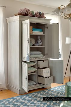 Repurposed Media Cabinet into Armoire. Look at all that storage room! (Painted in MMS Milk Paint in Shutter Gray  Grainsack.
