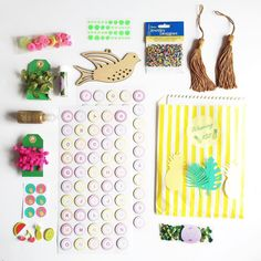 Here's the contents of the Totally Tropical July box!  A weaving kit leaf trim Pom Pom trim copper tassels seed beads buttons glitter some stickers tropical alpha wood cut out fruit stickers pineapple stickers two balls of wool glitter and sequins!  #craftsupplies #totallytropical #crafthaul #glitteryhandsbox #create #make #glitter #creativelifehappylife