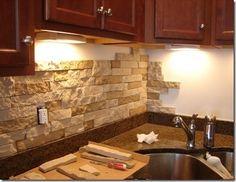 Stone backsplash to match island and fireplace