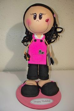 A craft foam doll made to look like my cousin who is a stylist. She has her brush, flat iron, scissors :)