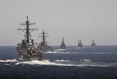 Arleigh Burke-class guided-missile destroyers USS Mahan (DDG 72) and USS Cole (DDG 67) maneuver into position behind three Japanese destroyers during a photo exercise.