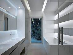Baños de estilo moderno por arkham project