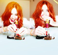 Karen Gillan who plays Amy Pond on Doctor Who.  Karen's playing with the Doctor and Amy Pond action figures...