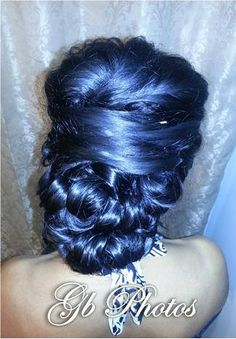 Side updo. Low bun with curls and puff.