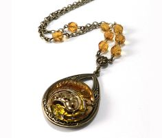 Antique Button Necklace, Vintage AMBER Glass BUTTON Necklace - Yellow Amber Gold Crystal Victorian Steampunk Jewelry by Compass Rose Design by CompassRoseDesign on Etsy https://www.etsy.com/listing/220537848/antique-button-necklace-vintage-amber