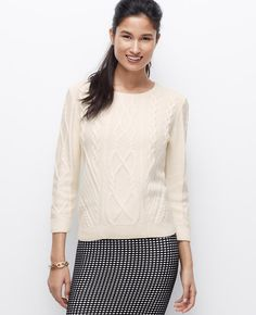 A cozy cable knit sweater is a cold weather essential, especially when cast in bright winter hues. Team it with luxe leather or graphic prints for a marvelously modern mix. Crew neck. 3/4 sleeves. Ribbed neckline, cuffs and hem.