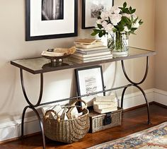 "Willow Console Table #potterybarn An antiqued-mirror top rests on an elegantly curved base, creating a console with eye-catching presence. Place prized possessions on top to highlight their detail from every angle.  55"" wide x 18"" deep x 30"" high  Forged iron frame and an antiqued-mirror top.  Hand-applied multistep matte finish in Dark Bronze."