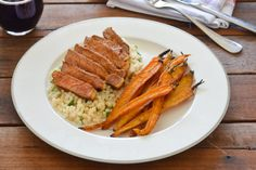 Thick-Cut Porterhouse Chipotle Steak with Roasted Baby Carrots & Minted…
