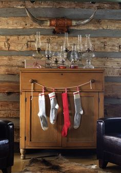 Rustic holiday lanterns and hang stockings from door pulls on buffet server Log Cabin Christmas, Little Christmas, Country Christmas, All Things Christmas, Christmas Holidays, Christmas Decorations, Holiday Decor, Cowboy Christmas, Christmas Ideas