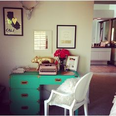 Home office--LOVE the interesting color & nature of the desk paired with a tailored chair