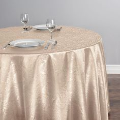 108 in. Round Baroque Embossed Satin Tablecloth Beige