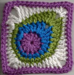 peacock feather granny square instructions. Could leave off the square part if you wanted to make a peacock costume.