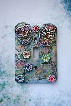 A Sugar Skull Nightmare toggle wall plate switch by TMBakerDesigns Sugar Skull Decor, Sugar Skull Art, Candy Skulls, White Clay, Halloween Skull, Polymer Clay Art, Skull And Bones, Switch Plates, Light Switch Covers